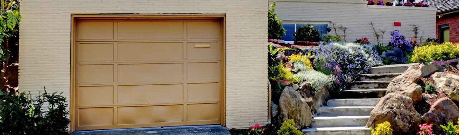 installer porte de garage alu 84300